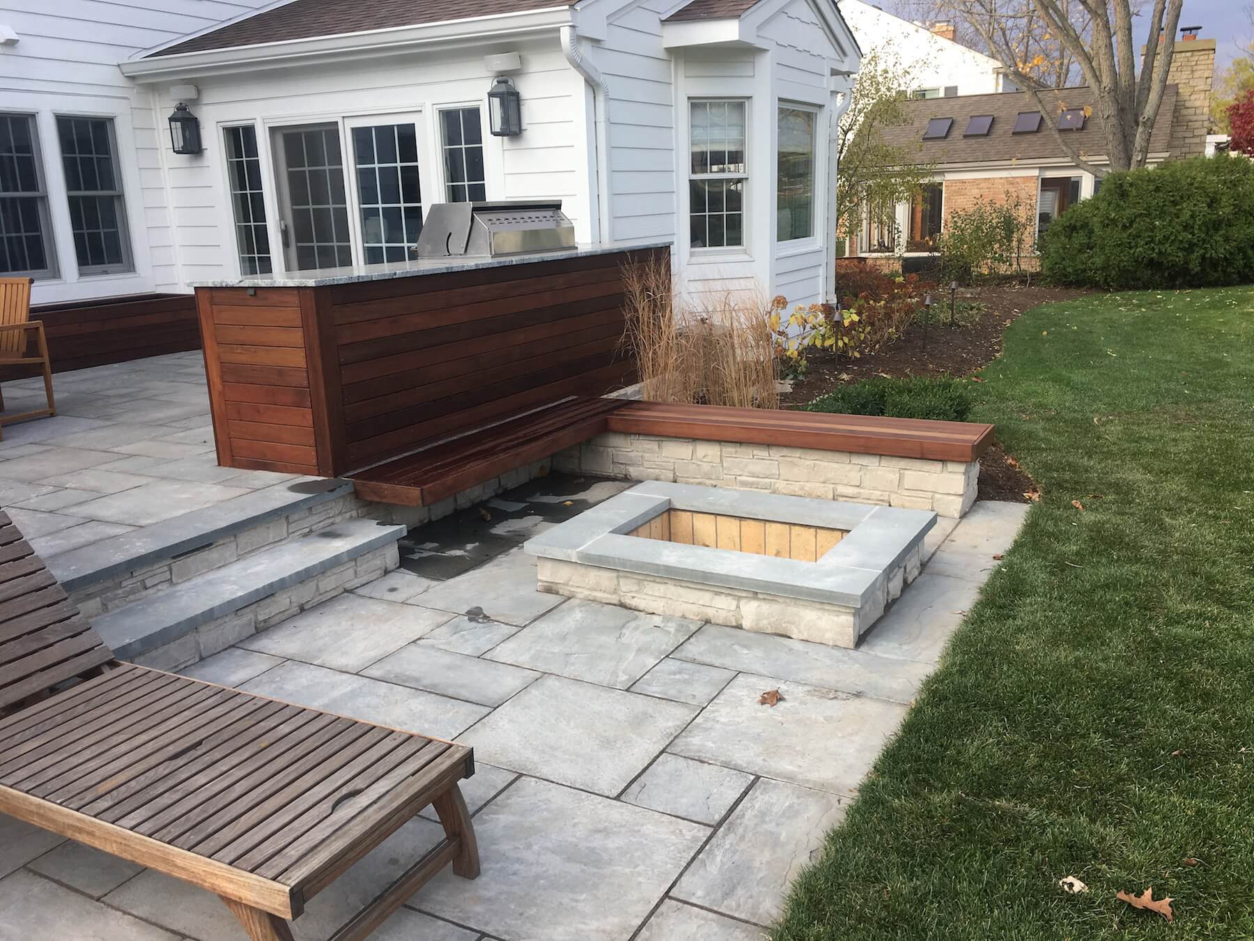 Stone paver patio with built in fireplace Denver Colorado