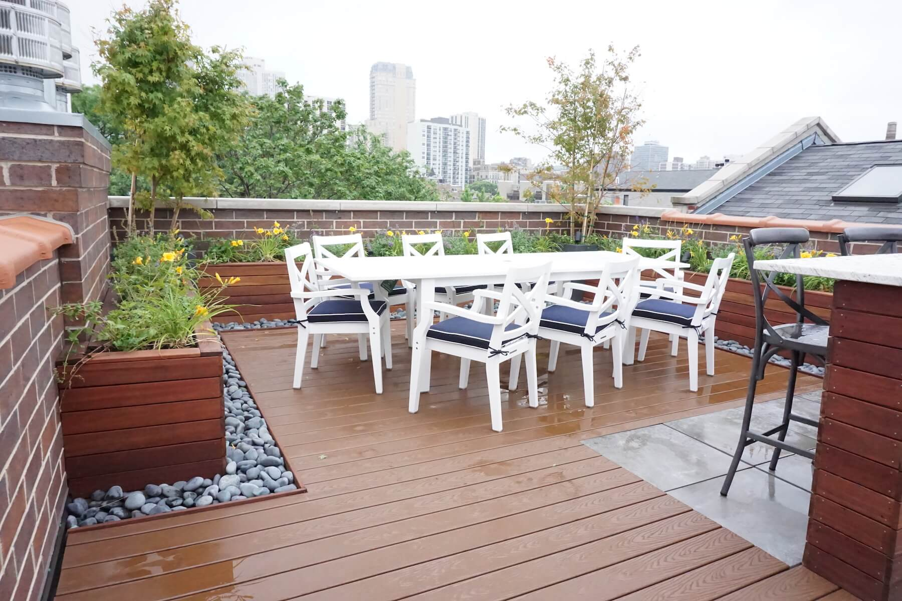 Rooftop Dining Area With Built-In Planters