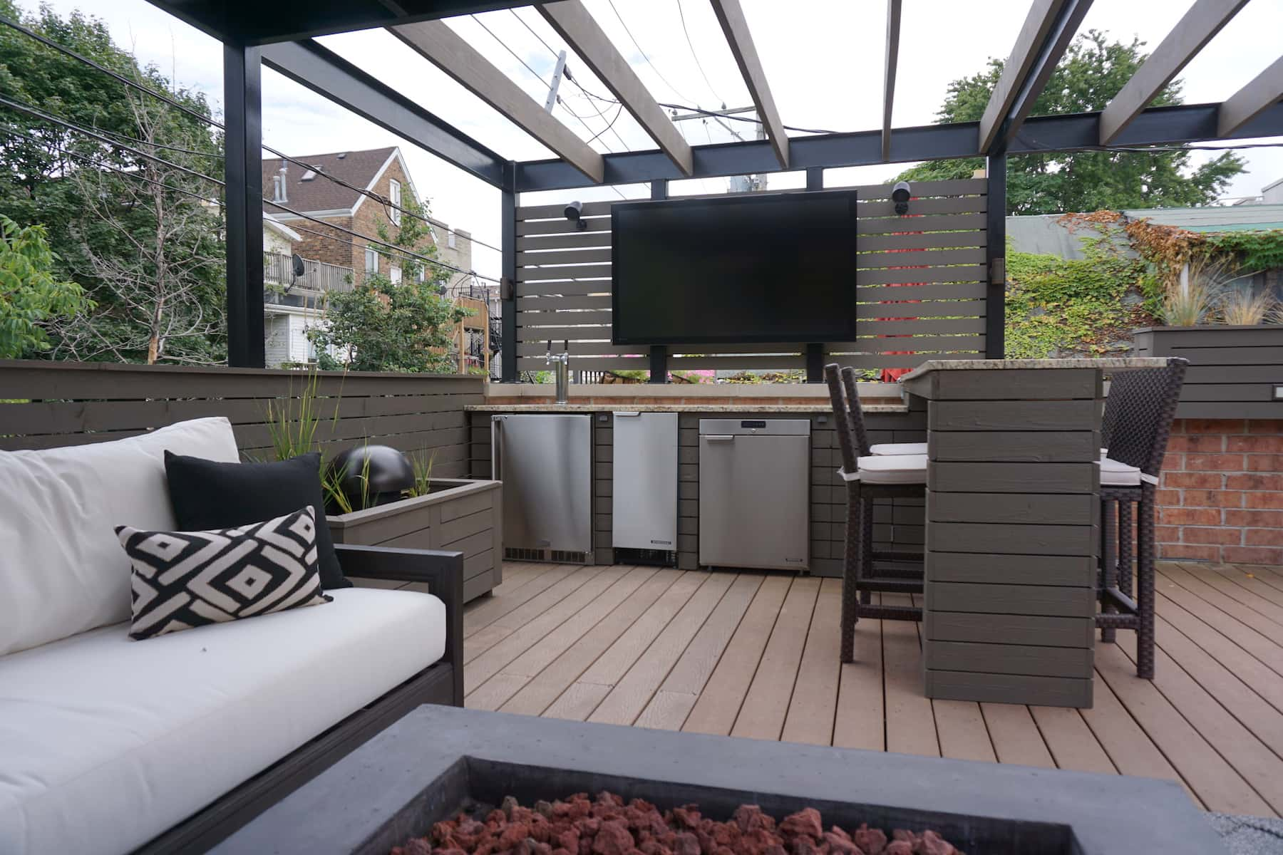 Outdoor furniture TV and pergola in Denver