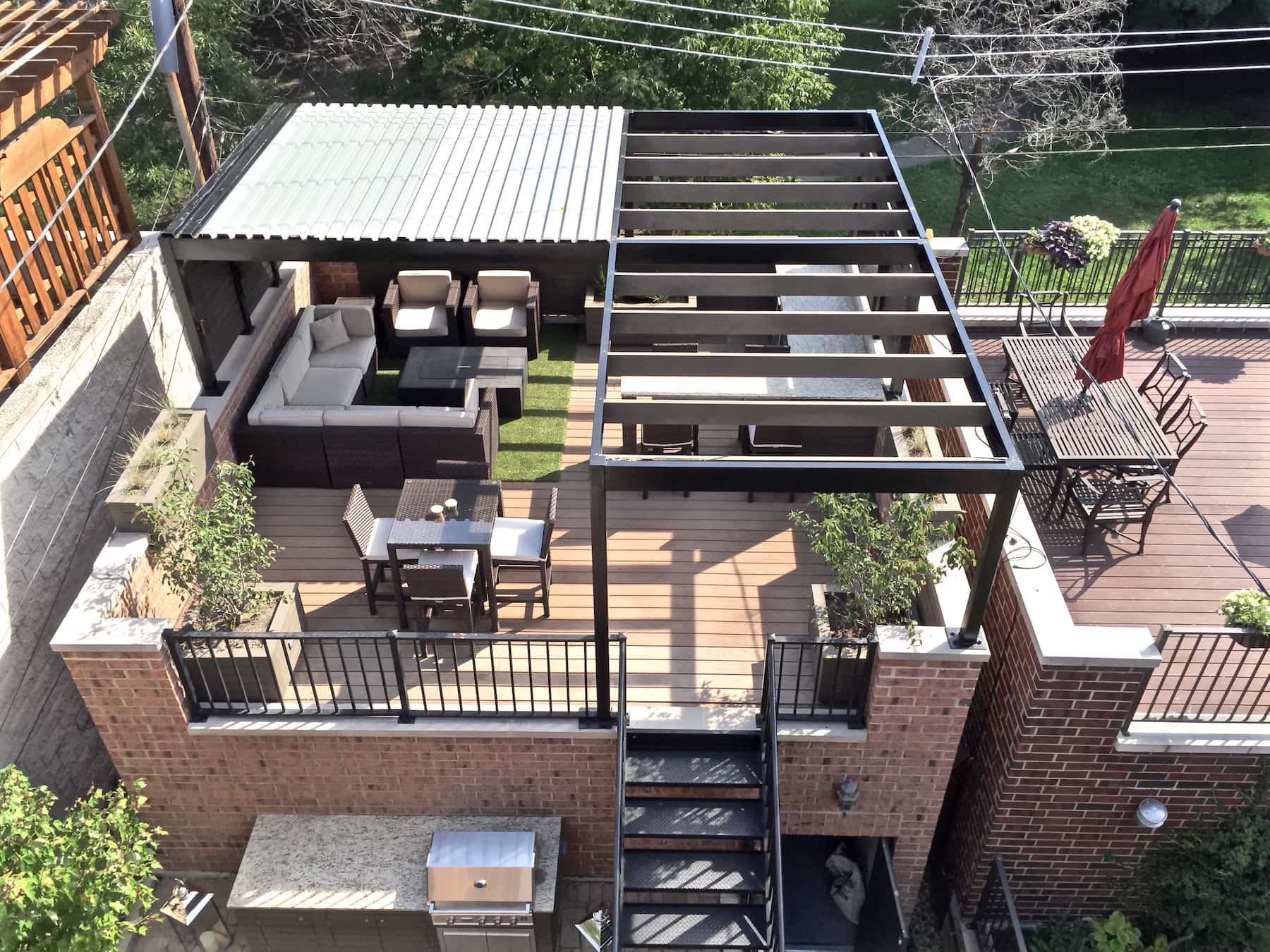 Modern Rooftop Deck With Pergola And Outdoor Kitchen