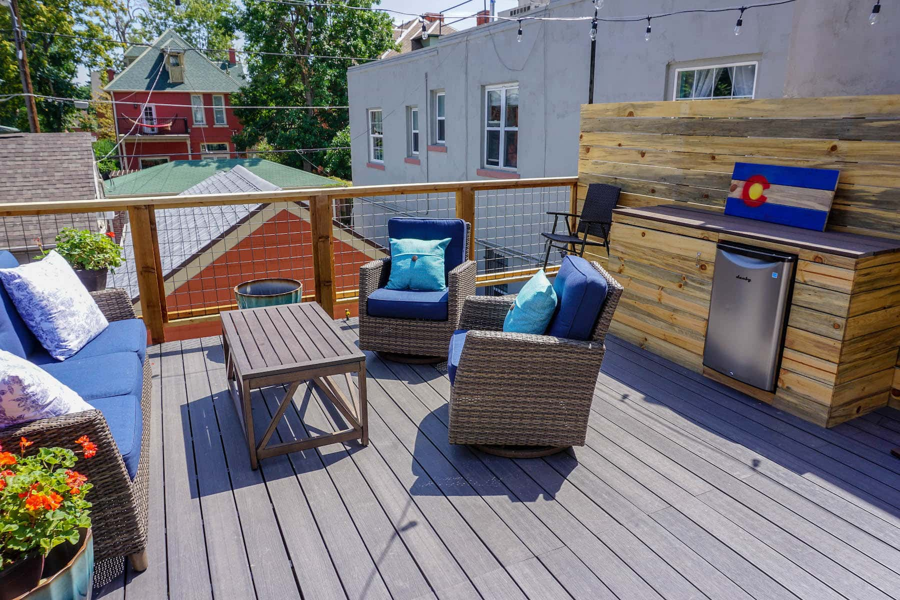 Elevated Deck With Seating and Outdoor Fridge