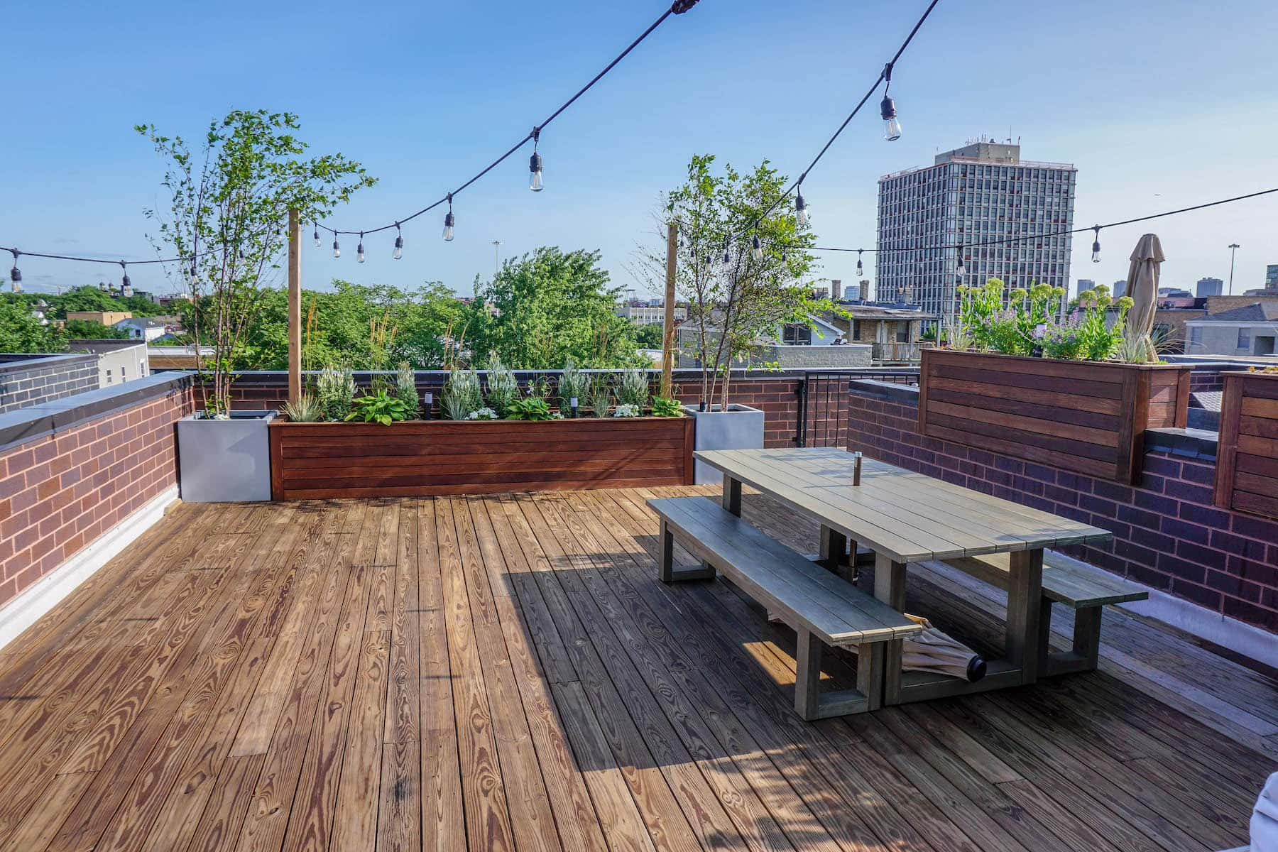 Rooftop Deck With Dining and Planters