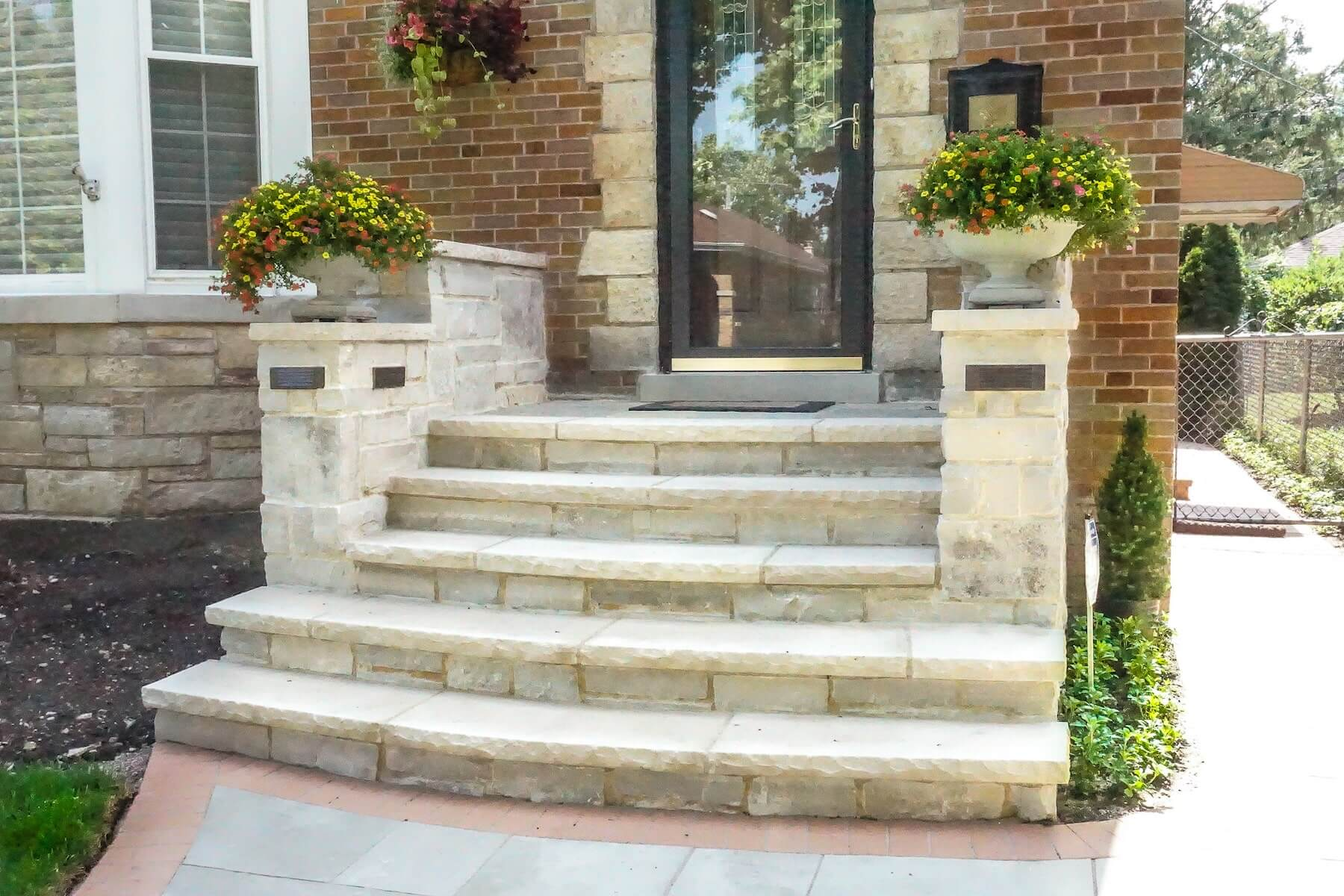 paver walkway stone entryway boulders plantings denver co